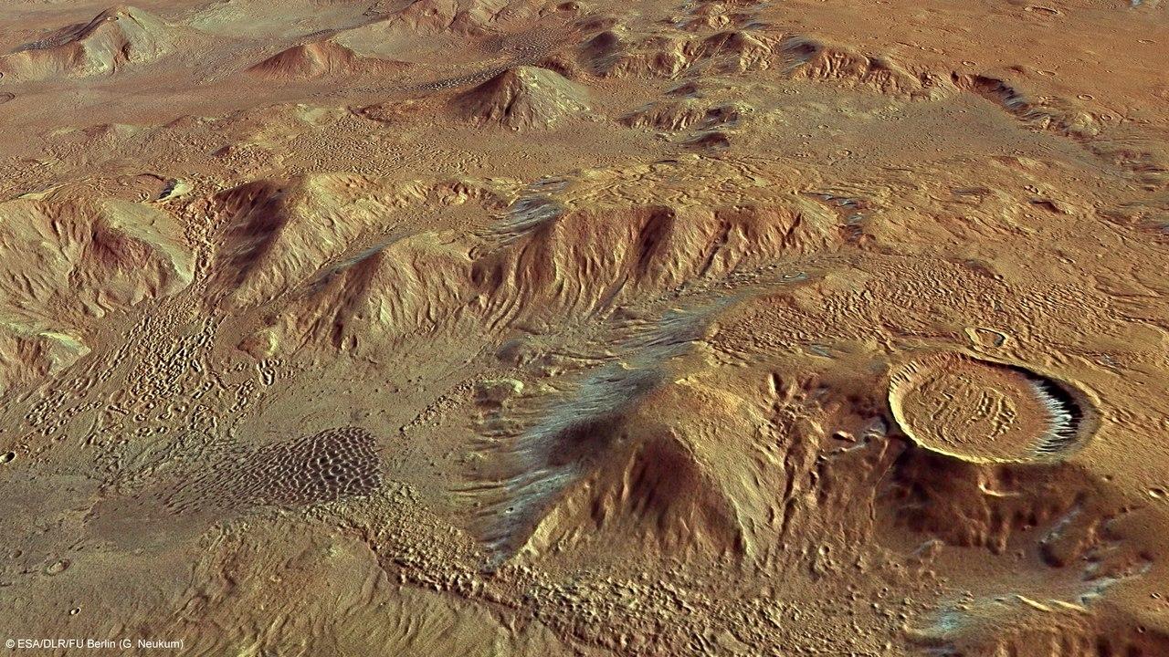 Вулканы повернули ось Марса