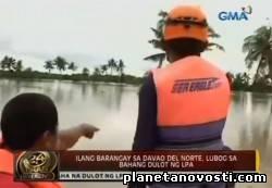 Бурлящая река на Филиппинах смела 200 домов (Видио)
