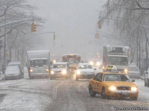 Снежная буря вновь атакует северо-восток США (9 фото)